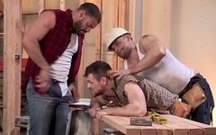 Bareback threesome with muscular hunks at construction site