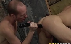 Bound young slave has his ass penetrated by sex toys and his masters cock
