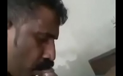 Indian uncle sucking cock