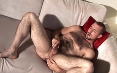 Hairy euro stud fingering his asshole