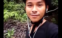 Cyclist passionately cums in the middle of a tropical rainforest