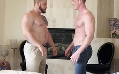 Muscular and bearded hunk barebacks his tattooed lover