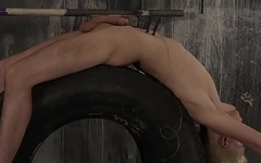 Roped to a tire sub slave cums while being wanked by master